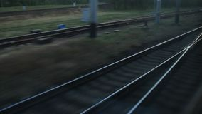 View from the train window, branching of the railway tracks, worker in the signal vest.  stock video