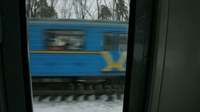 View from the train window. Train goes to the meeting. View from the train window. Passenger transportation by railway stock footage