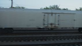 View from the train window, one white freight car stands on the railway. White wagon stock video footage