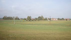 View from train window - rural landscape of farms, fields, trees sunny day. Autumn, Europe stock video
