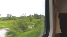 View from a train window. View of the rural scene of Thailand from a train window stock footage