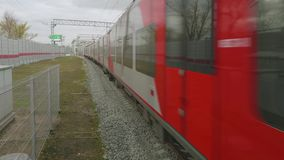 View of traing arriving in station of moscow central circle. On cloudy afternoon stock video