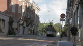 View from 5 tram moving in the city at the day, Amsterdam, Netherlands. AMSTERDAM, NETHERLANDS - AUGUST 9, 2016: View of 5 tram moving along the street in the stock video footage