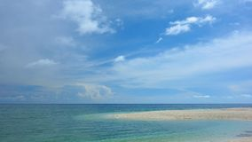 A view of the tranquil sea. Sandy beach on the island of Camiguin, Philippines Stock Photo
