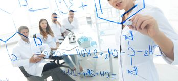 View through the transparent Board. female biochemist analyzing information. Stock Images
