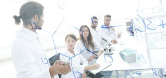 View through the transparent Board. a scientist makes a report. Royalty Free Stock Photo