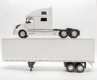 View of transport truck and trailer model on white, grey background Stock Photography
