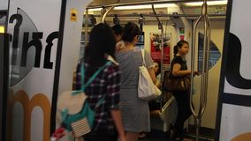View of Transportation system in Bangkok. Skytrain Bangkok, Thailand, commonly known as the BTS. with people inside the train stock footage