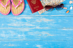 View of travel items lying on blue wooden background. Royalty Free Stock Image