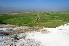 View from travertine terraces with a view to Pamukkale Royalty Free Stock Photo