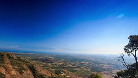 View of Tree Tops and Valley from Hill and Blue Sky stock footage