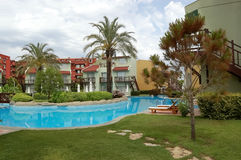View of trees around pool in hotel, Turkey. Royalty Free Stock Photos