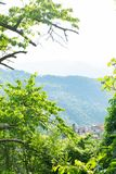 View through trees of distant hills. Above the village of Benabbio in the Tuscany region of Italy royalty free stock photography