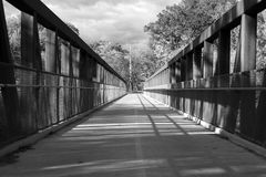 View of Trees Through Steel Bridge in Chicago, Grayscale Stock Images