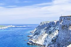 View of Tremiti islands with blue water, boats and clouds. Gargano. Puglia, Italy. for nature, travel and holyday concepts royalty free stock photo