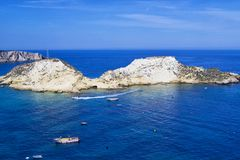 View of Tremiti islands with blue water, boats and clouds. Gargano. Puglia, Italy. for nature, travel and holyday concepts Royalty Free Stock Photography
