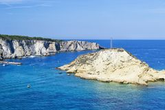 View of Tremiti islands with blue water, boats and clouds. Gargano. Puglia, Italy. for nature, travel and holyday concepts stock images