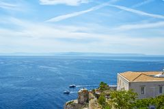 View of Tremiti islands with blue water, boats and clouds. Gargano. Puglia, Italy. for nature, travel and holyday concepts Royalty Free Stock Images