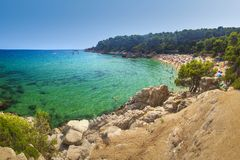 View on Treumal beach in Lloret de Mar, Costa Brava, Spain on sunny summer day. Cala Treumal beach. Vacation on tropical mediterranean sea. Turquoise water royalty free stock images