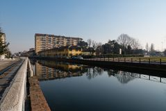 View of Trezzano sul naviglio reflected on the canal. Lombardy, Italy Royalty Free Stock Photography
