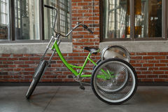 View of tricycle classic bike with aluminum beer barrel on the back Stock Images