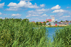 View on Trinity Catholic church in Glubokoe from behind lake, Be Royalty Free Stock Image