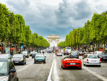 The view of the Triumphal arch to the Champs-Elysees. Paris, France. PARIS, FRANCE - AUGUST 13, 2014: The view of the Triumphal arch to the Champs-Elysees. The royalty free stock images