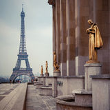 View from Trocadero on Eiffel tower, Paris. View from Trocadero with golden statues on Eiffel tower, Paris Royalty Free Stock Photography