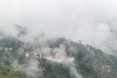 View of Trongsa Dzong with foggy hills, Bumthang, Bhutan, Asia. Royalty Free Stock Image