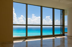 View of tropical beach through hotel windows Stock Photography