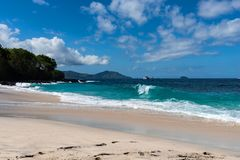 View of tropical beach, sea rocks and turquoise ocean, blue sky. White Sand Beach, Bali Indonesia. stock images