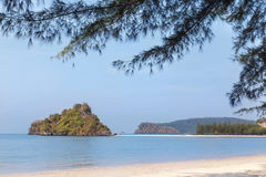 View of the tropical beach with small limestone island in andaman sea Stock Photography