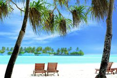View of tropical beach with sun loungers. On summer day Stock Image
