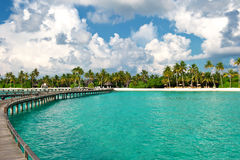 View of tropical island beach with blue sky. View of tropical island beach with beautiful blue cloudy sky Royalty Free Stock Image