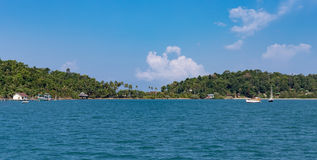 View of the tropical island from the sea Stock Images