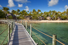 View on tropical island from the wooden bridge Stock Photography