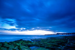View of tropical rocky beach landscape at sunrise Royalty Free Stock Image