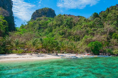 View of tropical sandy beach, Palawan, Philippines. Scenic view of beautiful tropical white sand beach and rock island, El Nido, Palawan, Philippines Royalty Free Stock Photo