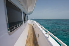 View of tropical sea from private luxury yacht. View down the side of a luxury private motor yacht on a tropical ocean Stock Image