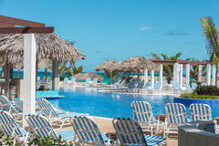 View of tropical swimming pool and tranquil ocean background Royalty Free Stock Photo