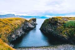 View trough the cliffs near Gatklettur, Iceland. stock photo