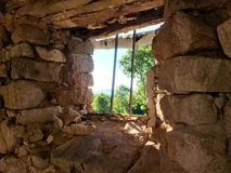 View trough the window. Looking trough the window of a ruin Royalty Free Stock Photography
