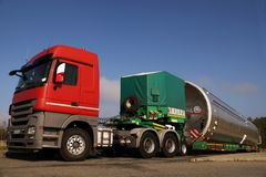 A view of a truck, a low-loader semi-trailer and an oversized ca stock photos