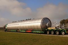 A view of a truck, a low-loader semi-trailer and an oversized ca stock images