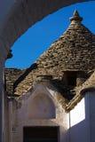 View of trullo through an arch Stock Photo