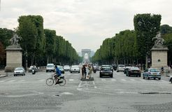 View of the Trumphal Arch in Paris from the Place de la Concorde through the Champs Elysees stock image