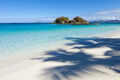 View of trunk bay. With shadow of palm tree on beach Royalty Free Stock Image