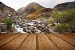 View of Tryfan looking up Ogwen Falls in Autumn Fall with wooden royalty free stock photography