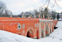 View of Tsaritsyno park in Moscow. Old bridge made of red bricks. Royalty Free Stock Photo