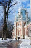 View of Tsaritsyno park in Moscow in winter. People walk along the Palace. Royalty Free Stock Photo